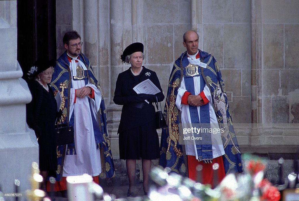 Queen Elizabeth II and Queen Mother at Funeral of Diana, Princess of Wales - At Westminster Abbey awaiting the arrival of the coffin of Diana, Princess of Wales, dressed in black standing next to priests. .