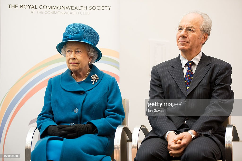 Queen Elizabeth II and Royal Commonwealth Society Chairman Peter Kellner sit on stage during her visit to the Royal Commonwealth Society on November 14, 2012 in London, England.
