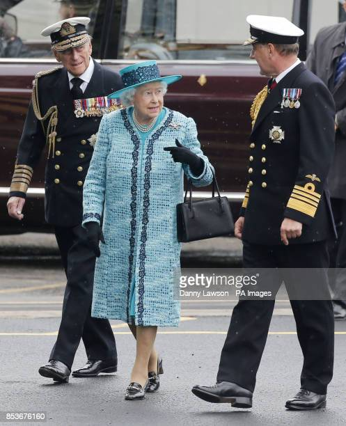 Queen Elizabeth II and the Duke of Edinbugh walk with First Sea Lord Admiral Sir George Zambellas at the formal naming ceremony for HMS Queen...