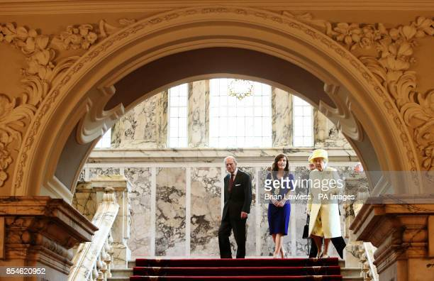 Queen Elizabeth II and the Duke of Edinburgh accompanied by Belfast Lord Mayor Nichola Mallon on their departure from City Hall Belfast during a...