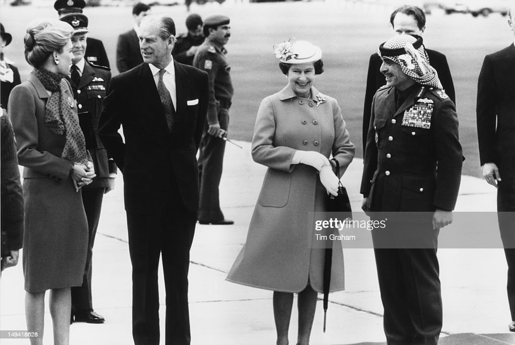 Queen Elizabeth II and the Duke of Edinburgh are greeted by King Hussein of Jordan (1835 - 1999) and Queen Noor of Jordan upon their arrival in Amman, Jordan, 26th March 1984.