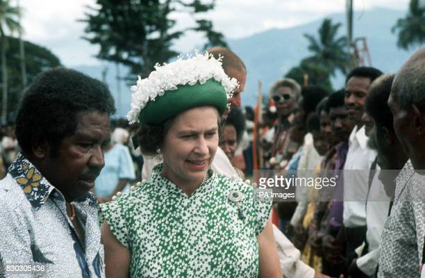 Queen Elizabeth II and the Duke of Edinburgh are presented with Personalities of Alotau when they were given a public welcome at Alice Wodega Park...