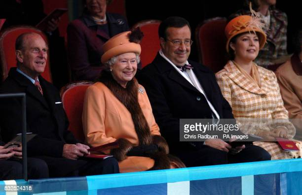 Queen Elizabeth II and the Duke of Edinburgh are seated beside the President of Estonia Toomas Hendrik Ilves and his wife Evelin Ilves as they watch...