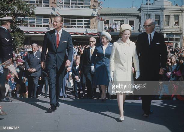 Queen Elizabeth II and the Duke of Edinburgh are shown around the State Library of Victoria and various museums in Melbourne by Dr Louis Matheson...