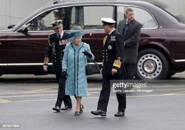 Queen Elizabeth II and the Duke of Edinburgh arrive at HMS Queen Elizabeth in Rosyth Dockyard Fife where the Queen will formally name the Royal...