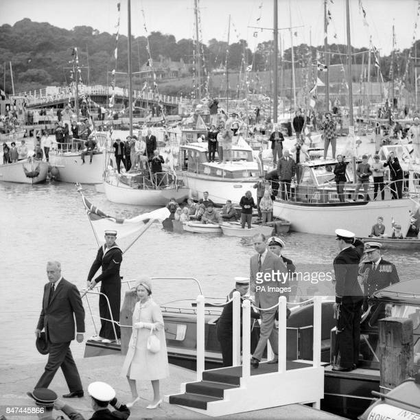 Queen Elizabeth II and the Duke of Edinburgh come ashore from the Royal Yacht during their visit to the Isle of Wight Preceding them is the new...