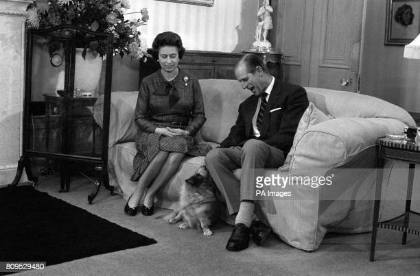 Queen Elizabeth II and the Duke of Edinburgh during their traditional summer break at Balmoral Castle The royal couple are seen with 'Tinker' a cross...