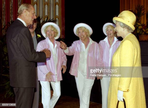 Queen Elizabeth II and the Duke of Edinburgh enjoy an impromptu song by the Beverley Sisters Babs Joy and Teddie at the Broadway Theatre in Catford...