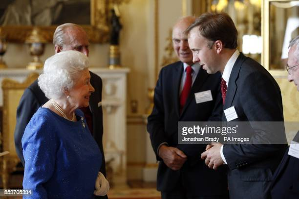 Queen Elizabeth II and The Duke of Edinburgh greet Matthew Hancock as they host a reception at Buckingham Palace for winners of The Queen's Awards...