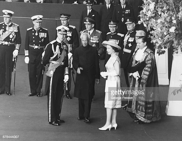Queen Elizabeth II and the Duke of Edinburgh greeting Sarvepalli Radhakrishnan President of India as he arrives at Victoria Station London June 12th...