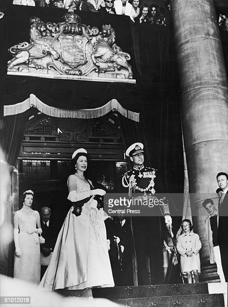 Queen Elizabeth II and the Duke of Edinburgh pause for the royal salute and national anthem during the opening of the New Zealand parliament 18th...