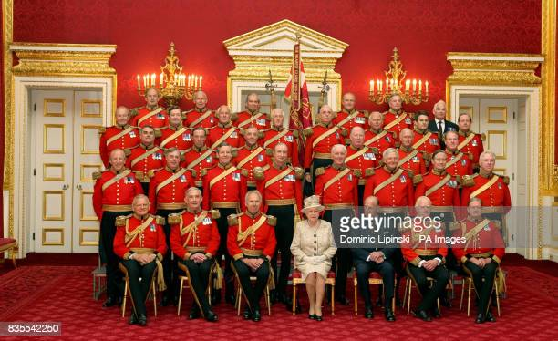 Queen Elizabeth II and the Duke of Edinburgh pose for a group photograph with members of the Gentlemen at Arms at St James's Palace London as part of...