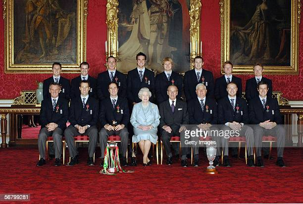 Queen Elizabeth II and the Duke of Edinburgh pose with members of England's 2005 Ashes winning Cricket team after collecting their honours at an...