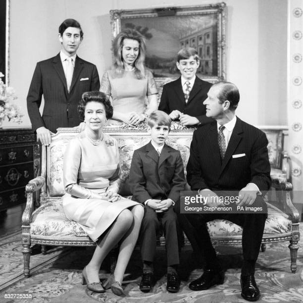 Queen Elizabeth II and the Duke of Edinburgh pose with their children for a Silver Wedding day group in the Belgian suite at Buckingham Palace Left...