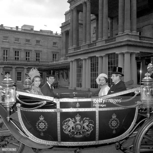 Queen Elizabeth II and the Duke of Edinburgh sit in an open carriage facing their children The Prince of Wales and Princess Anne prior to them...