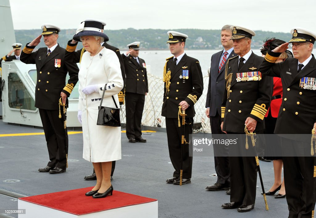 Queen <a gi-track='captionPersonalityLinkClicked' href=/galleries/search?phrase=Elizabeth+II&family=editorial&specificpeople=67226 ng-click='$event.stopPropagation()'>Elizabeth II</a> and the Duke of Edinburgh stand to attention during the National Anthem aboard HMCS St John's on June 29, 2010 in Halifax, Canada. The Queen and Duke of Edinburgh are on an eight day tour of Canada starting in Halifax and finishing in Toronto. The trip is to celebrate the centenary of the Canadian Navy and to mark Canada Day. The royal couple will make their way to New York where the Queen will address the UN and visit Ground Zero on July 6.