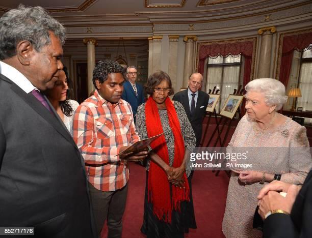 Queen Elizabeth II and the Duke of Edinburgh talk with Kevin Namajtira the grandson and Lenie Namatjira the granddaughter of Albert Namajtira the...