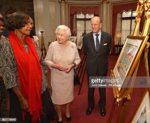 Queen Elizabeth II and the Duke of Edinburgh talk with Lenie Namatjira the granddaughter of Albert Namajtira the Aboriginal artist during a private...
