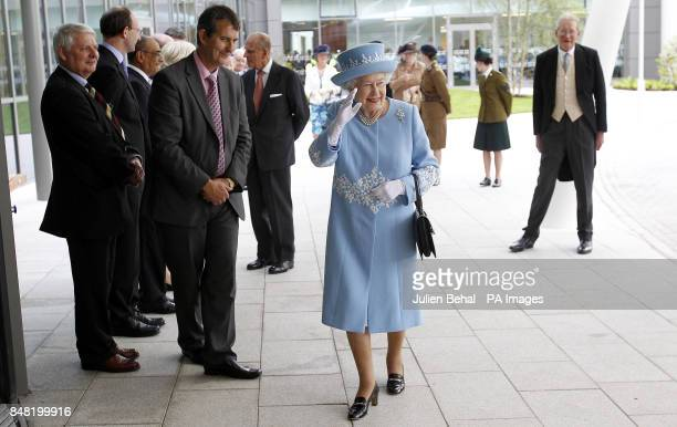 Queen Elizabeth II and the Duke of Edinburgh visit the new South West Acute Hospital in Enniskillen County Fermanagh watched by Health Minister Edwin...