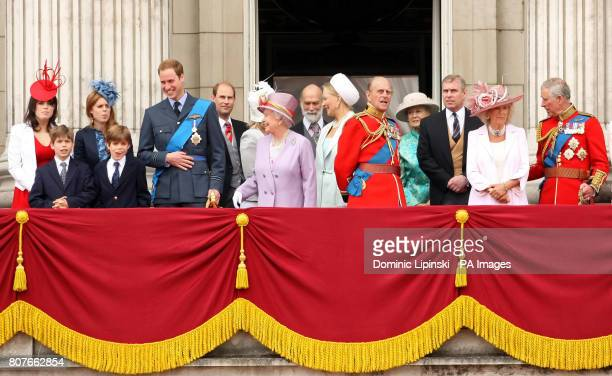 Queen Elizabeth II and the Duke of Edinburgh watch a flypast from the balcony of Buckingham Palace central London alongside other members of the...