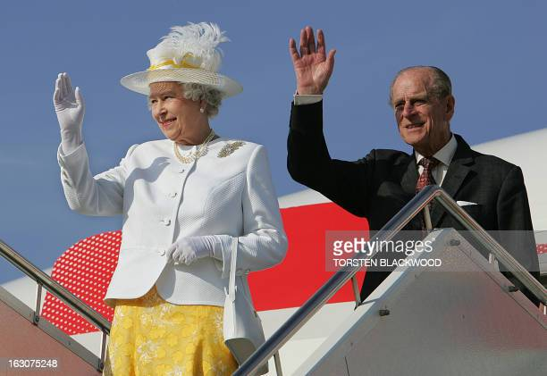 Queen Elizabeth II and The Duke of Edinburgh wave as they disembark from their chartered Boeing 777 in Canberra 12 March 2006 at the start of their...