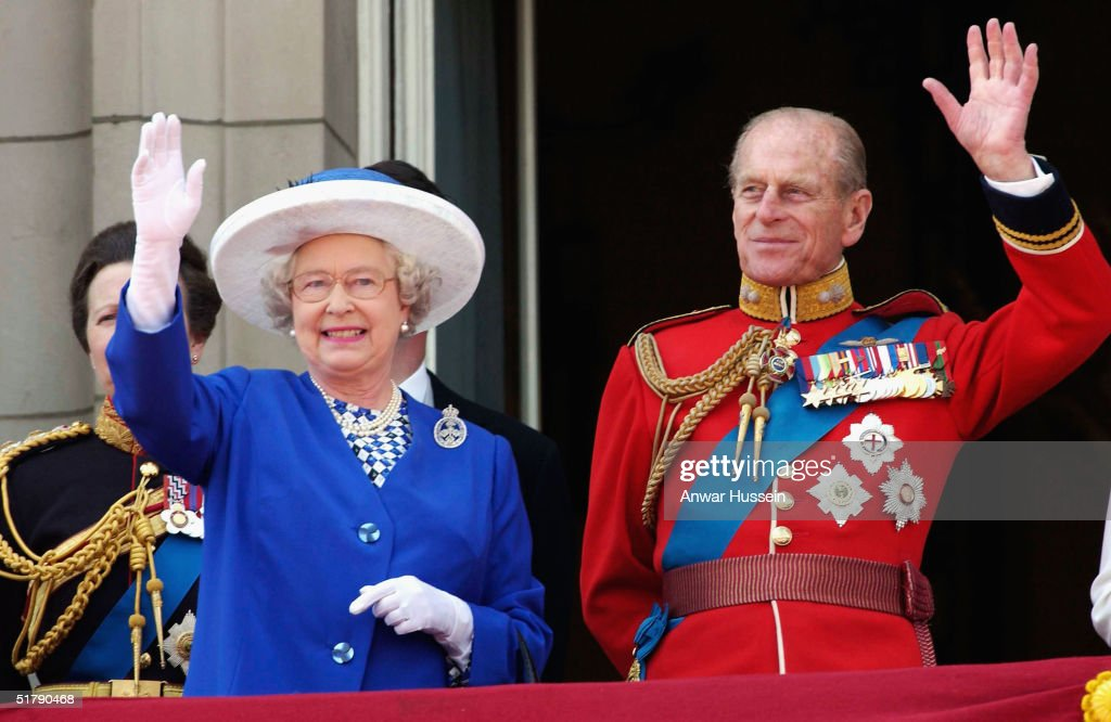Queen Elizabeth II and the Duke of Edinburgh wave from the balcony after Trooping of the Colour at Buckingham Palace in this June 14, 2003 file photo in London, England.