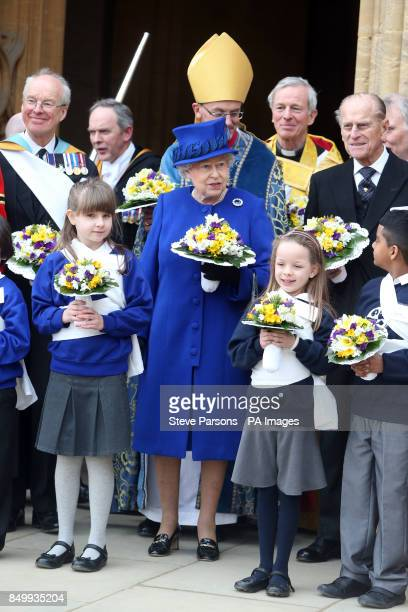 Queen Elizabeth II and the Duke of Edinburgh with children as they leave Christ Church Cathedral in Oxford following the Royal Maundy service
