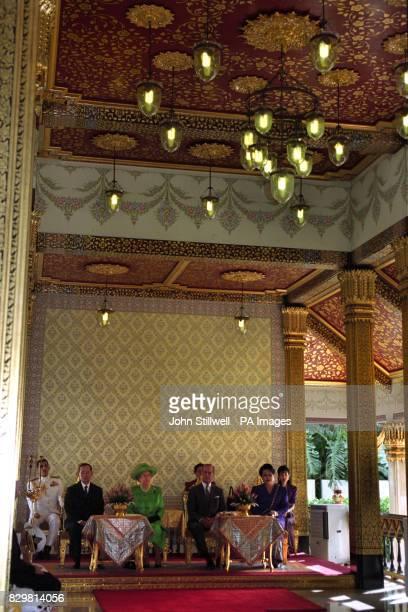 Queen Elizabeth II and the Duke of Edinburgh with their host King Bhumibol of Thailand following their arrival in Bangkok