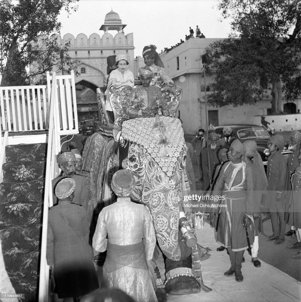 Queen Elizabeth II and The Maharaja of Jaipur Sawai Man Singh II ride on an elephant on February 6 1961 in Rawalpindi Pakistan