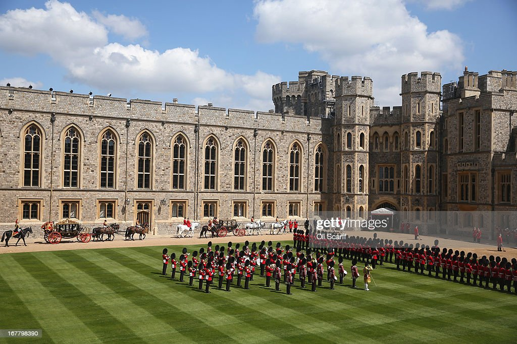 Queen Elizabeth II and The President of the United Arab Emirates, His Highness Sheikh Khalifa bin Zayed Al Nahyan, arrive by horse-drawn carriage in the Quadrangle of Windsor Castle on April 30, 2013 in Windsor, England. The President of the United Arab Emirates is paying a two-day State Visit to the United Kingdom, staying in Windsor Castle as the guest of Her Majesty The Queen from April 30, 2013 to May 1, 2013. Sheikh Khalifa will meet the British Prime Minister David Cameron tomorrow at his Downing Street residence.