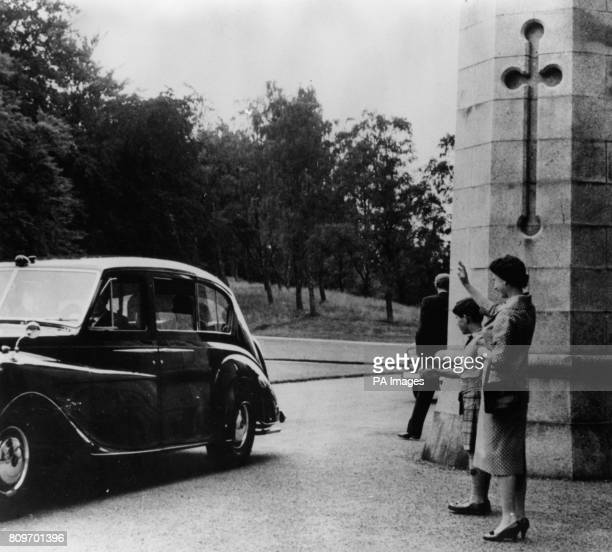 Queen Elizabeth II and the Prince of Wales wave goodbye to Dr Kwame Nkrumah Prime Minister of Ghana at Balmoral Castle after his oneday visit