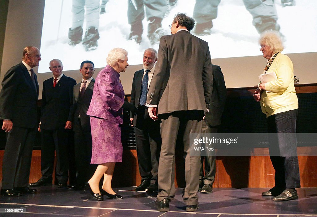 Queen <a gi-track='captionPersonalityLinkClicked' href=/galleries/search?phrase=Elizabeth+II&family=editorial&specificpeople=67226 ng-click='$event.stopPropagation()'>Elizabeth II</a> and the <a gi-track='captionPersonalityLinkClicked' href=/galleries/search?phrase=Prince+Philip&family=editorial&specificpeople=92394 ng-click='$event.stopPropagation()'>Prince Philip</a>, Duke of Edinburgh meet some of the relatives of members of the 1953 Everest expedition, including Peter Hilary (2L, son of Sir Edmund Hilary) and Jamling Norgay (3L, son of Tenzing Norgay), during a reception to celebrate the 60th Anniversary of the ascent of Everest, at the Royal Geographical Society in Kensington, on May 29, 2013 in Kensington, West London, England.