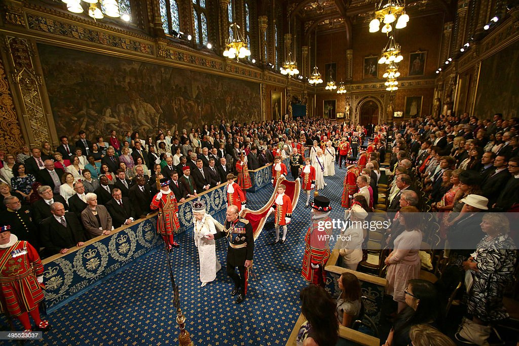 Queen Elizabeth II and the Prince Philip Duke of Edinburgh proceed through the Royal Gallery during the State Opening of Parliament in the House of...