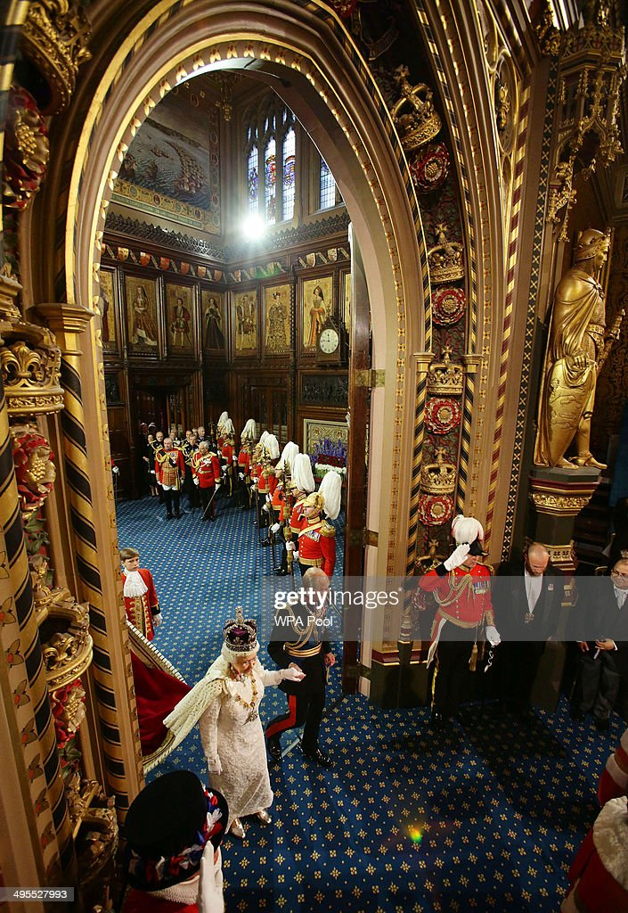 Queen Elizabeth II and the Prince Philip Duke of Edinburgh proceed through the Royal Gallery after the State Opening of Parliament in the House of...