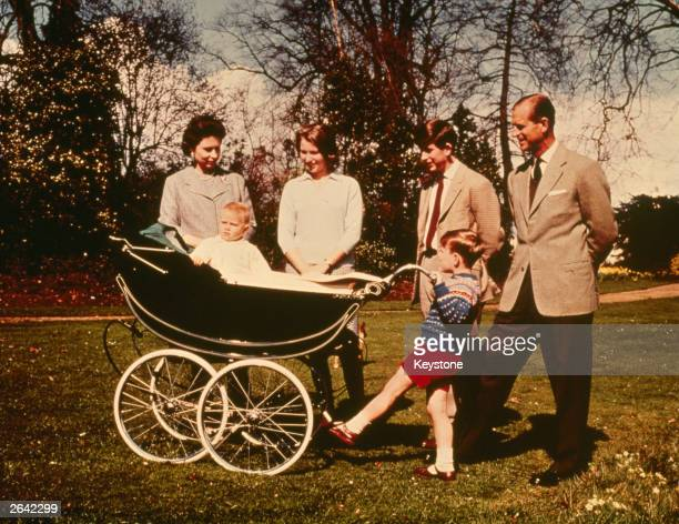 Queen Elizabeth II and The Prince Philip Duke of Edinburgh with their children Charles Prince of Wales Prince Andrew Prince Edward and Princess Anne...