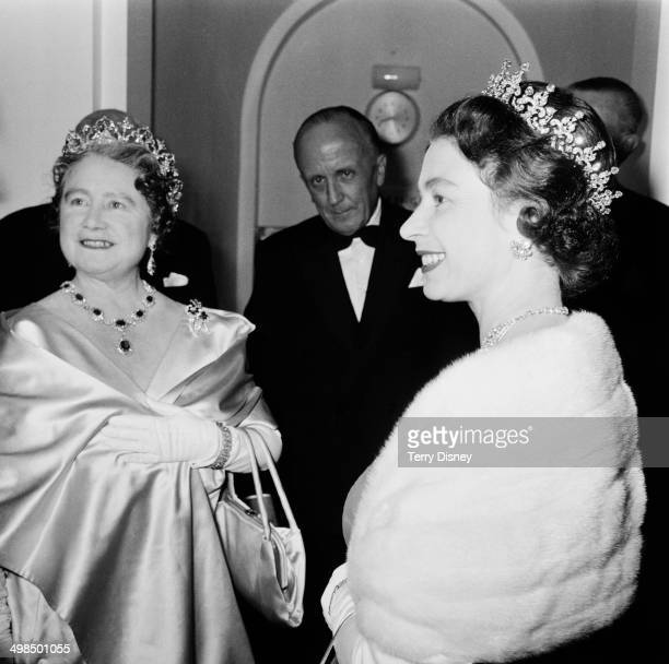 Queen Elizabeth II and the Queen Mother attend a performance at RADA to celebrate the drama school's Diamond Jubilee London UK November 1964