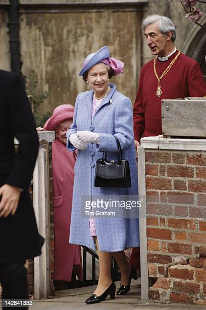 Queen Elizabeth II and the Queen Mother attend the Easter service at St George's Chapel Windsor circa 1987 They are accompanied by the Dean of Windsor