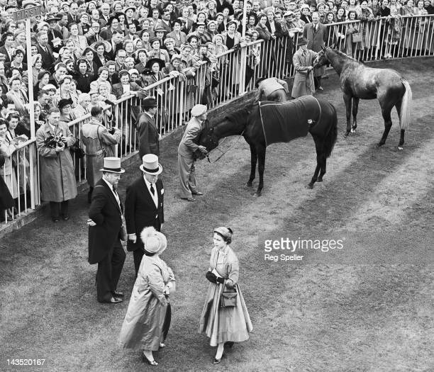 Queen Elizabeth II and the Queen Mother chatting in the unsaddling enclosure at Ascot after the Queen's horse Choirboy won the Royal Hunt Cup 17th...