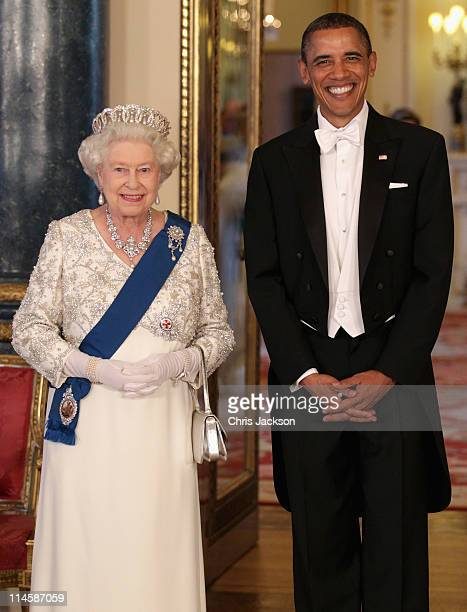 Queen Elizabeth II and US President Barack Obama pose in the Music Room of Buckingham Palace ahead of a State Banquet on May 24 2011 in London...
