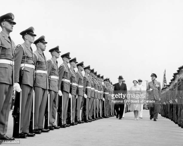 Queen Elizabeth II and US President Dwight D Eisenhower review the troops on the day of the official opening of the St Lawrence Seaway St Lambert...