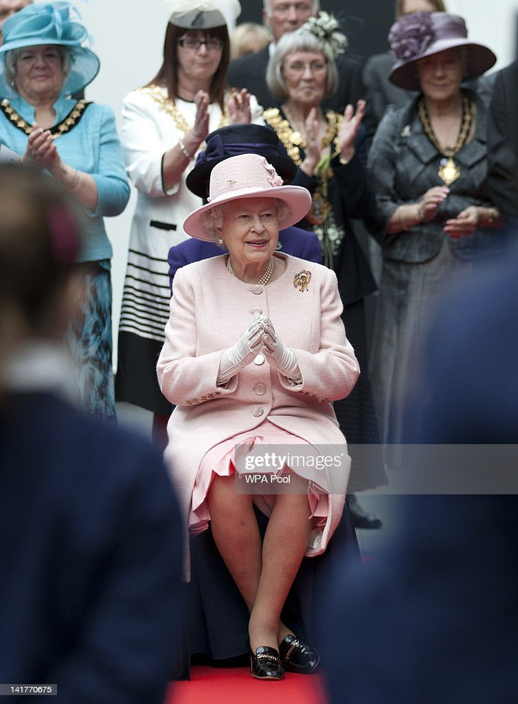 Queen <a gi-track='captionPersonalityLinkClicked' href=/galleries/search?phrase=Elizabeth+II&family=editorial&specificpeople=67226 ng-click='$event.stopPropagation()'>Elizabeth II</a> applauds a choir performance during her visit to the Manchester Central convention centre on March 23, 2012 in Greater Manchester, north-west England. The Queen and her husband, Prince Philip, the Duke of Edinburgh visited Manchester where she officially opened hospitals, toured the new BBC building at MetroCity and officially started a Sport Relief Mile fun run.