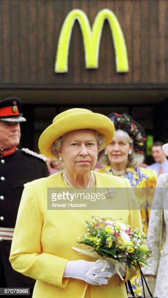 Queen Elizabeth II arrives at a McDonald's drivethru restaurant on a visit to Chesire Oaks Designer outlet in Ellesmere Port on July 31st 1998 in...