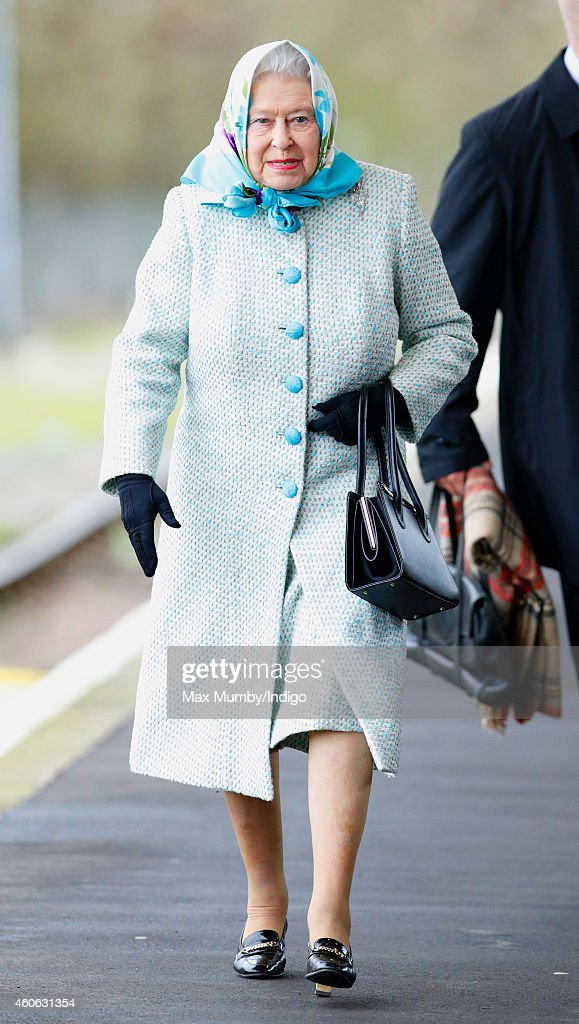 Queen Elizabeth II arrives at King's Lynn Railway Station, after taking the train from London King's Cross, to begin her annual Christmas break at Sandringham House on December 18, 2014 in King's Lynn, England.