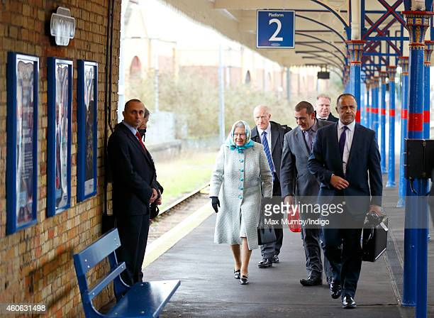 Queen Elizabeth II arrives at King's Lynn Railway Station after taking the train from London King's Cross to begin her annual Christmas break at...