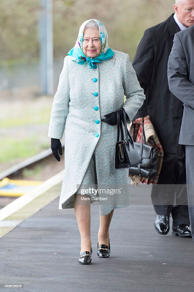 Queen Elizabeth II arrives at King's Lynn Station to begin her Christmas holiday at Sandringham on December 18, 2014 in King's Lynn, England.