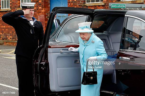 Queen Elizabeth II arrives at Portsmouth Naval Base for a tour of HMS Lancaster on May 20 2014 in Portsmouth England HMS Lancaster has recently...