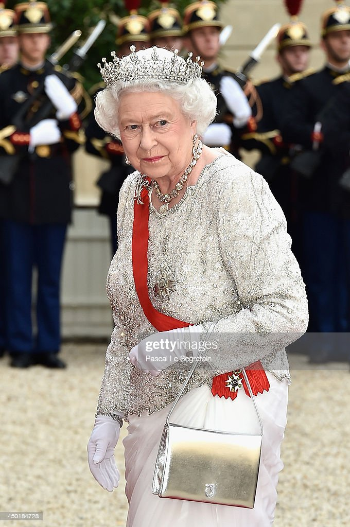 Queen <a gi-track='captionPersonalityLinkClicked' href=/galleries/search?phrase=Elizabeth+II&family=editorial&specificpeople=67226 ng-click='$event.stopPropagation()'>Elizabeth II</a> arrives at the Elysee Palace for a State dinner in honor of Queen <a gi-track='captionPersonalityLinkClicked' href=/galleries/search?phrase=Elizabeth+II&family=editorial&specificpeople=67226 ng-click='$event.stopPropagation()'>Elizabeth II</a>, hosted by French President Francois Hollande as part of a three days State visit of Queen <a gi-track='captionPersonalityLinkClicked' href=/galleries/search?phrase=Elizabeth+II&family=editorial&specificpeople=67226 ng-click='$event.stopPropagation()'>Elizabeth II</a> after the 70th Anniversary Of The D-Day on June 6, 2014 in Paris, France.