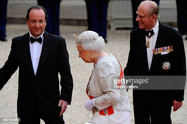 Queen Elizabeth II arrives at the Elysee Palace for a State dinner in honor of Queen Elizabeth II hosted by French President Francois Hollande as...