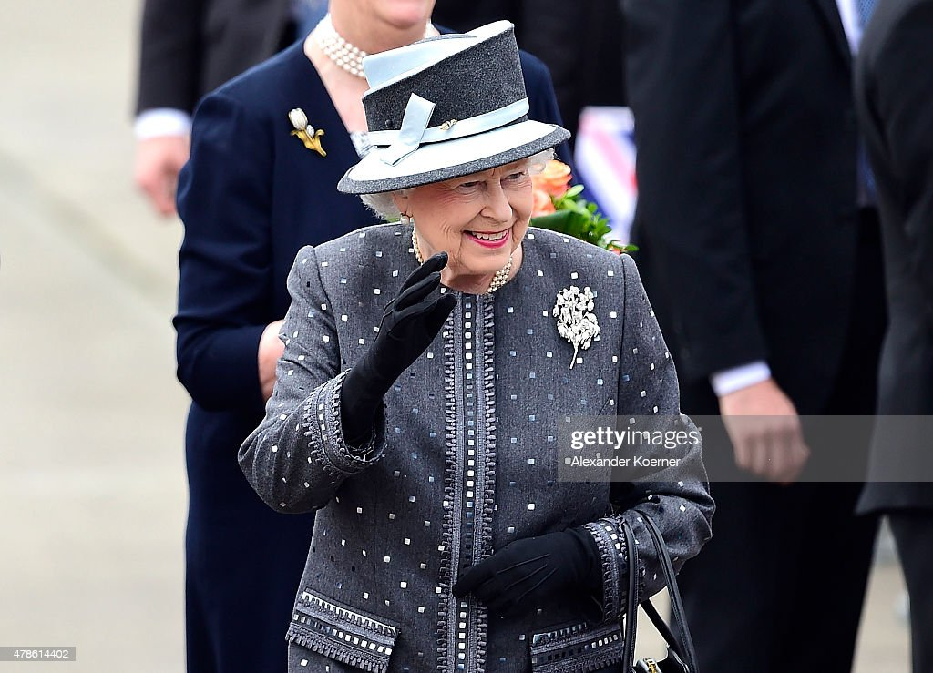 Queen Elizabeth II arrives at the military airport of Celle on June 26, 2015 in Celle, Germany. The Royal couple visited the concentration camp memorial at Bergen-Belsen this morning. This is the final day of a four day state visit, which is their first to Germany since 2004.