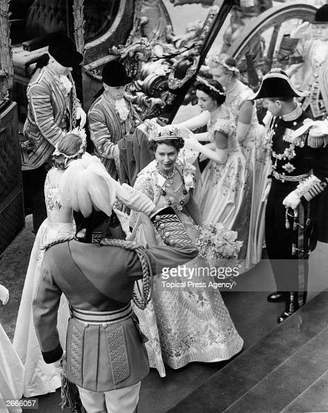 Queen Elizabeth II arrives at Westminster Abbey in the Coronation Coach wearing her Coronation robes and Sovereign crown With her are her Maids of...